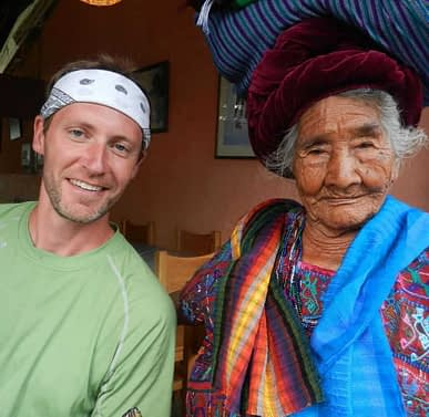 Run the World Adventures Guide Greg Jensen with a Guatemalan local woman in traditional garb.